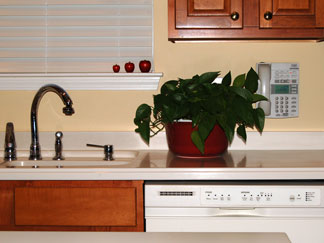 solid surface countertops and maple cabinets
